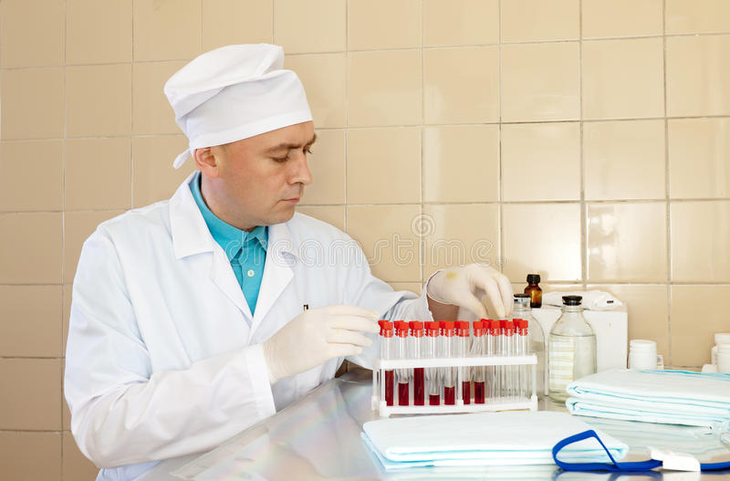 Download Male nurse with test tubes stock photo. Image of doctor - 27378470