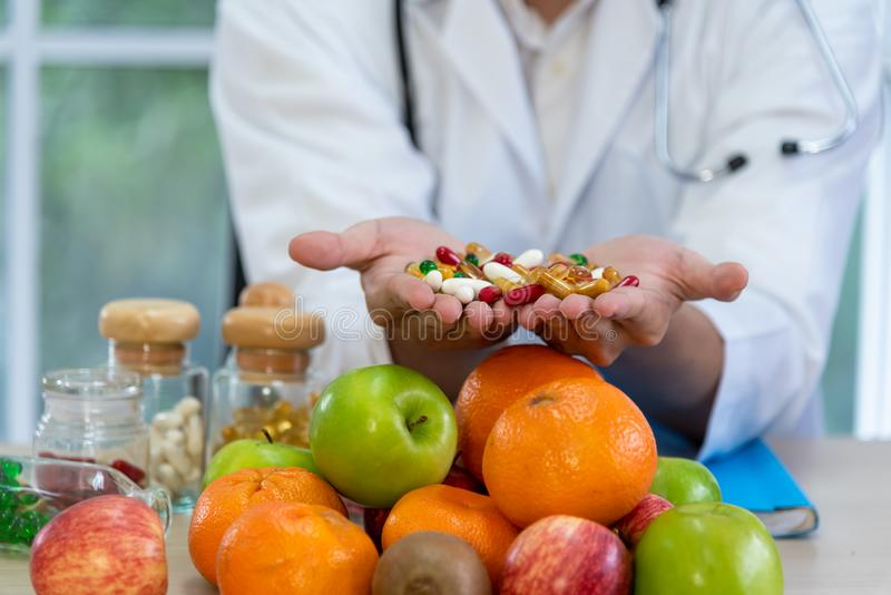 Male nutritionists are presenting fresh food and fruit royalty free stock photography