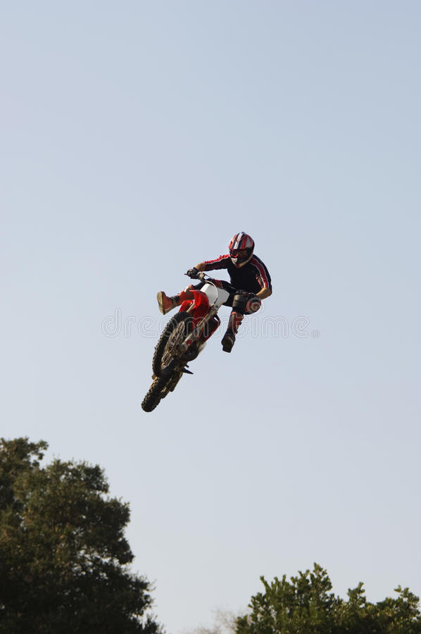 Male Off Road Rider Flying Through Air royalty free stock images