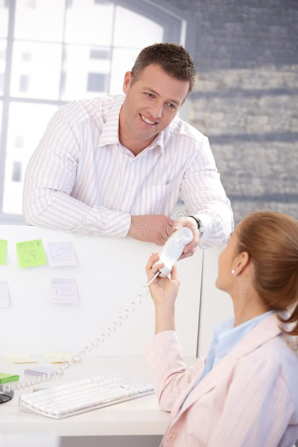 Download Male Office Worker Passing Phone To Colleague Stock Photo - Image: 18068812