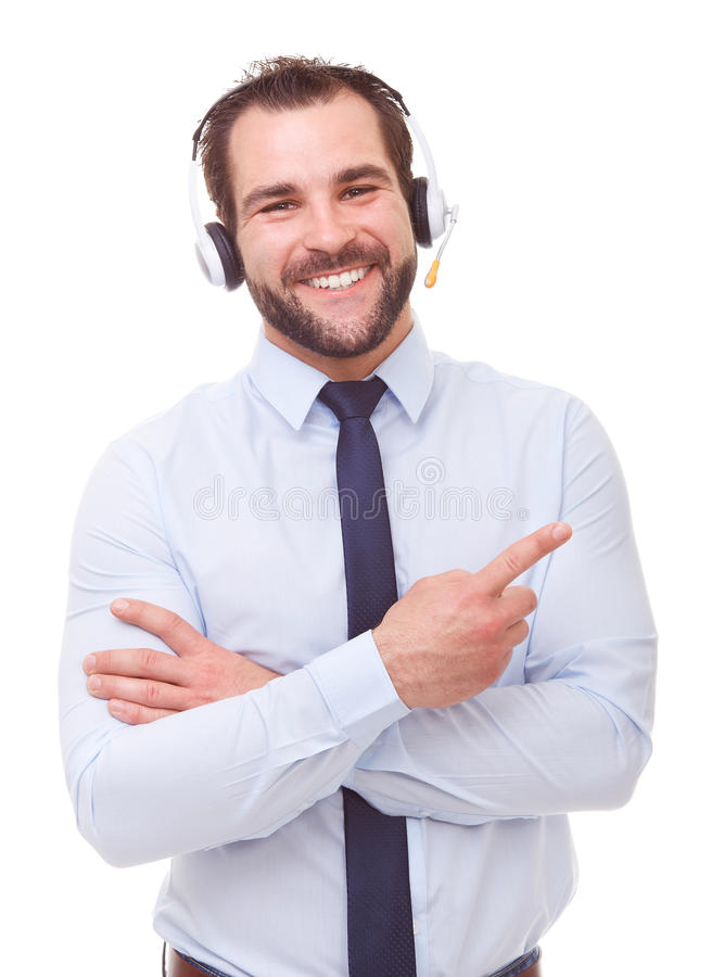 Male operator with headset showing empty copyspace. On white background stock image