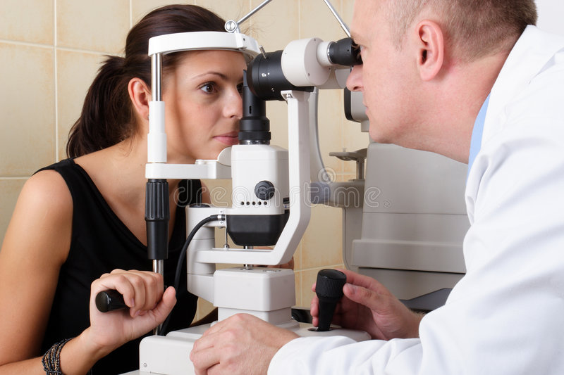 Male Ophthalmologist Conducting An Eye Examination Stock Image