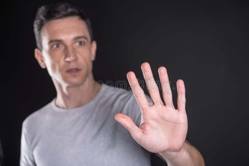 Male palm pressed to the transparent screen stock photo