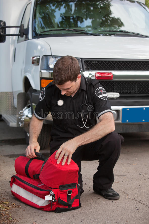 Male Paramedic With Oxygen Unit Royalty Free Stock Image