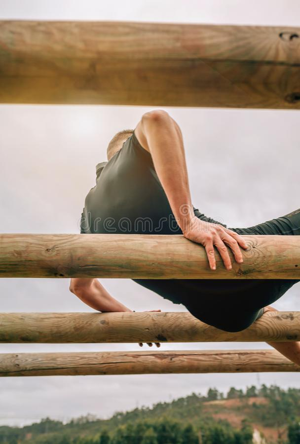 Participant in a obstacle course doing weaver. Male participant in a obstacle course doing weaver obstacle royalty free stock photography