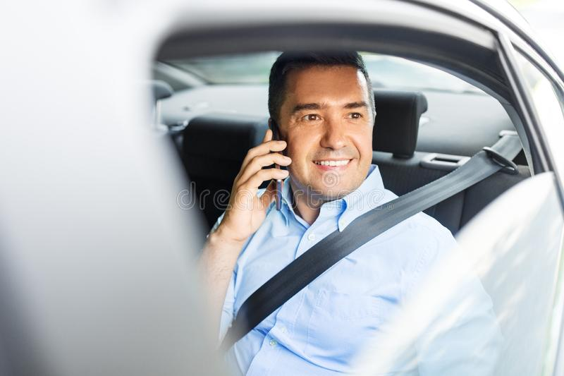 Male passenger calling on smartphone in taxi car stock images