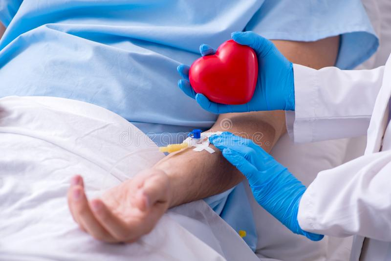 Male patient getting blood transfusion in hospital clinic royalty free stock photos