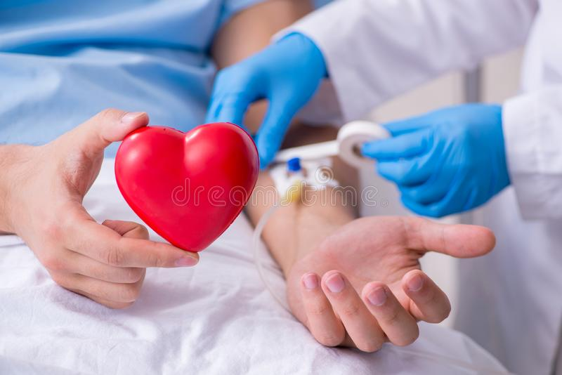 Male patient getting blood transfusion in hospital clinic royalty free stock image