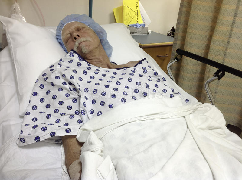 Male patient in hospital bed before surgery royalty free stock photos