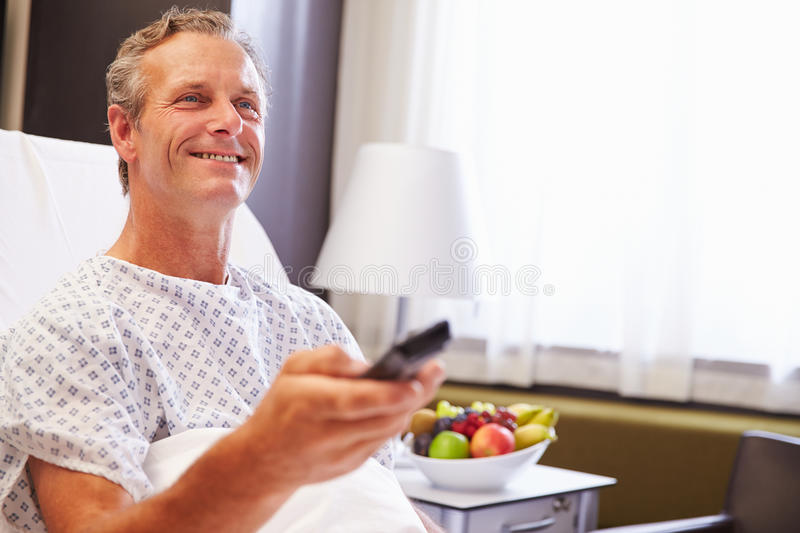 Male Patient In Hospital Bed Watching Television royalty free stock images