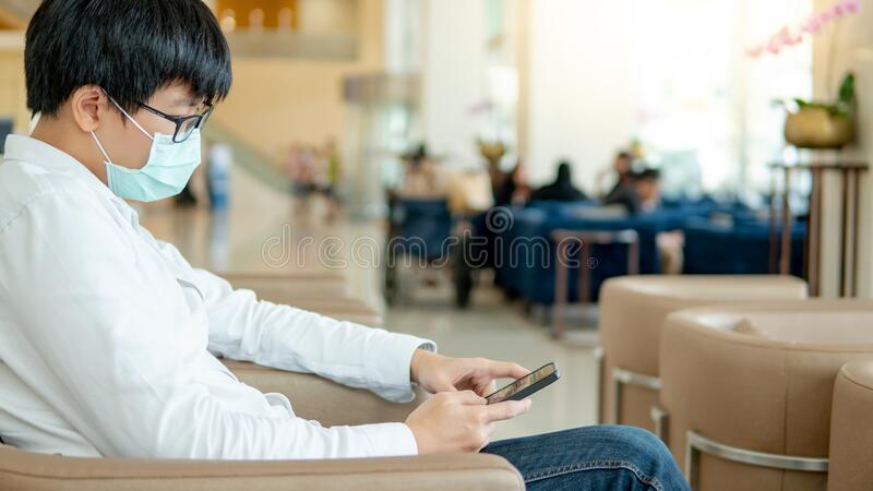 Male patient using smartphone in the hospital royalty free stock photos