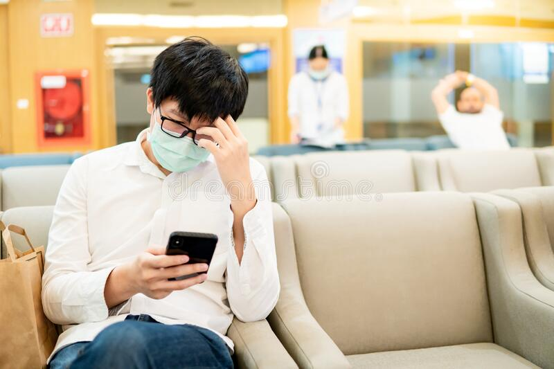 Male patient using smartphone in the hospital stock images