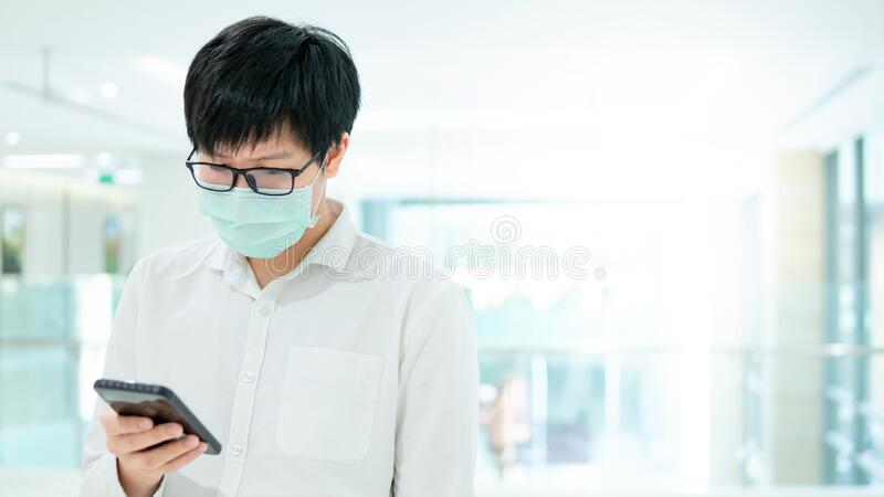 Male patient using smartphone in the hospital royalty free stock images