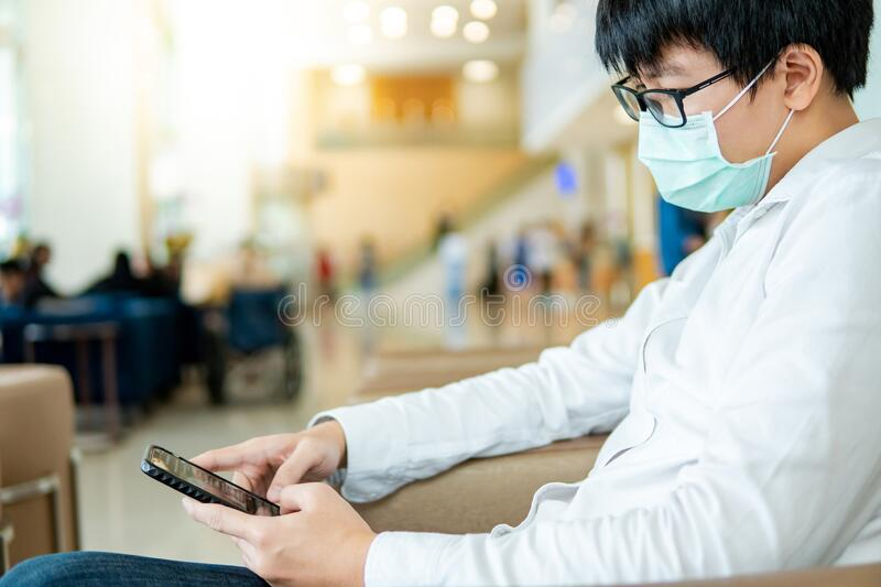 Male patient using smartphone in hospital royalty free stock photo