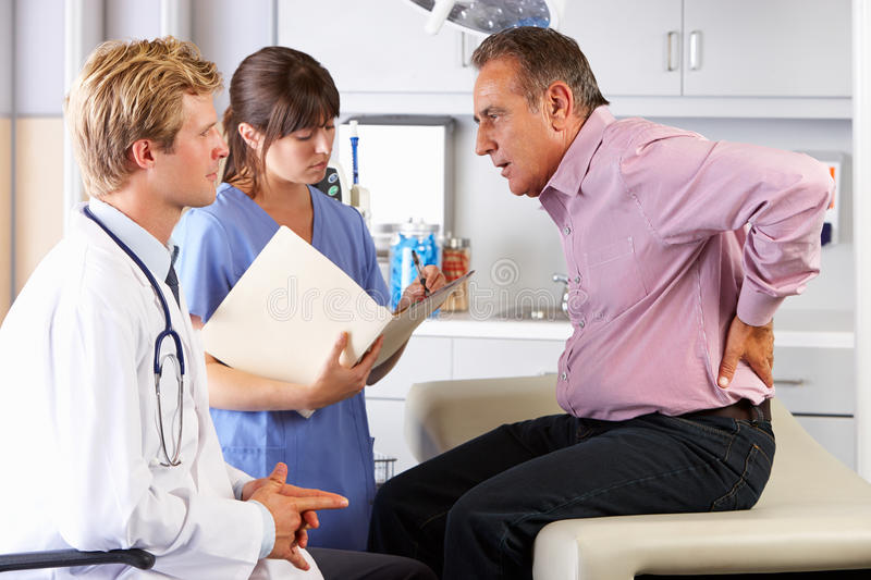 Download Male Patient Visiting Doctor's Office With Back Ache Stock Image - Image of medicine, notes: 28851439