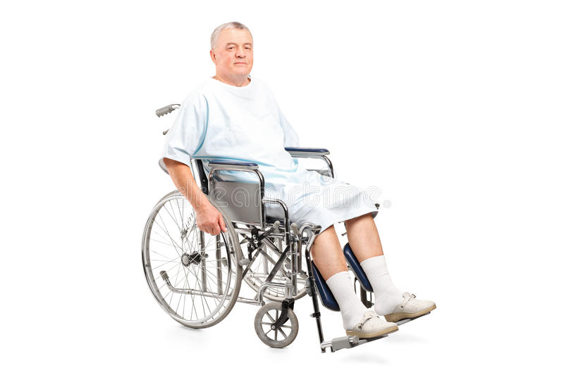 Male patient in a wheelchair. On white background royalty free stock photo
