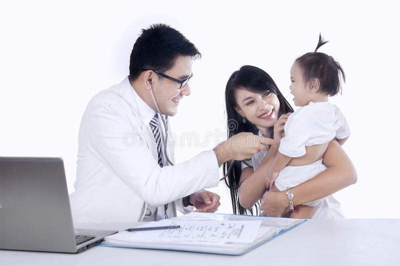 Male pediatrician and his patient 3. Mother and baby girl at the doctors office stock photography