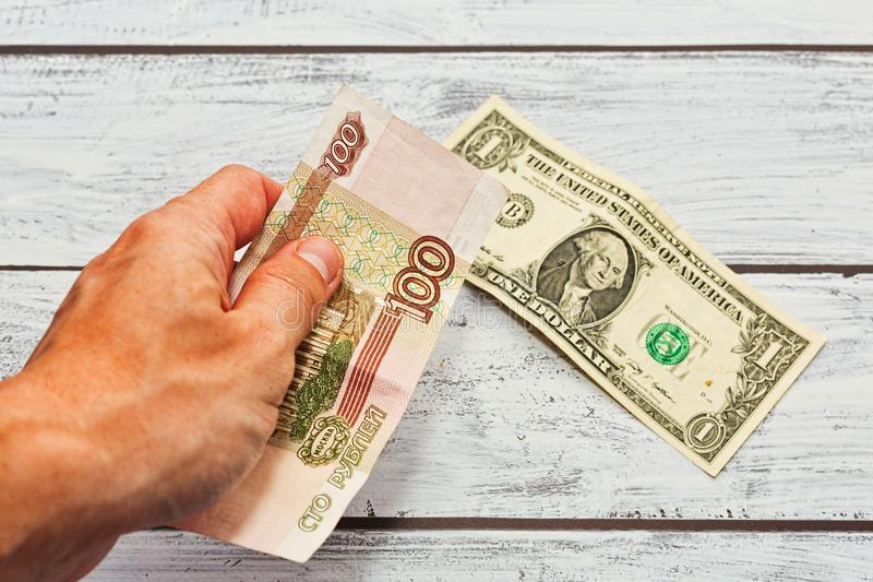 Person changing rubles to US dollars royalty free stock photography