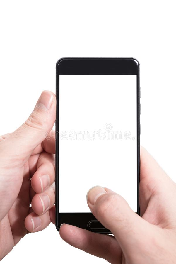 Male person using both hands to vertically hold smartphone with empty screen royalty free stock photography