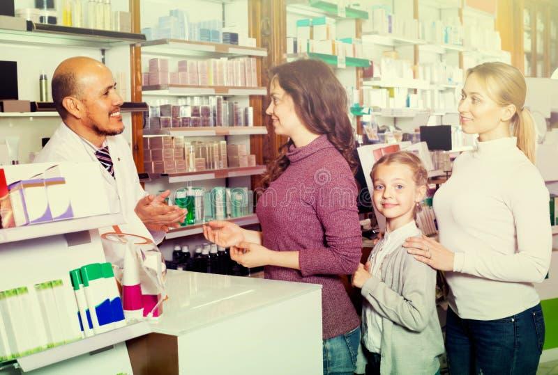 Male pharmacist in pharmacy royalty free stock photos