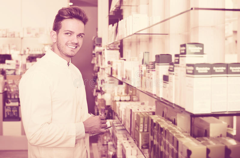 Download Male Pharmacist Wearing White Coat Standing  In Drug Store Stock Image - Image of occupation, glad: 83702343