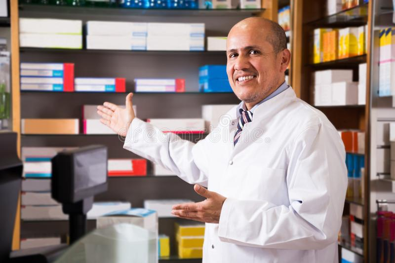 Male pharmacists working in farmacy. Portrait of mature male pharmacists working in modern drugstore royalty free stock images