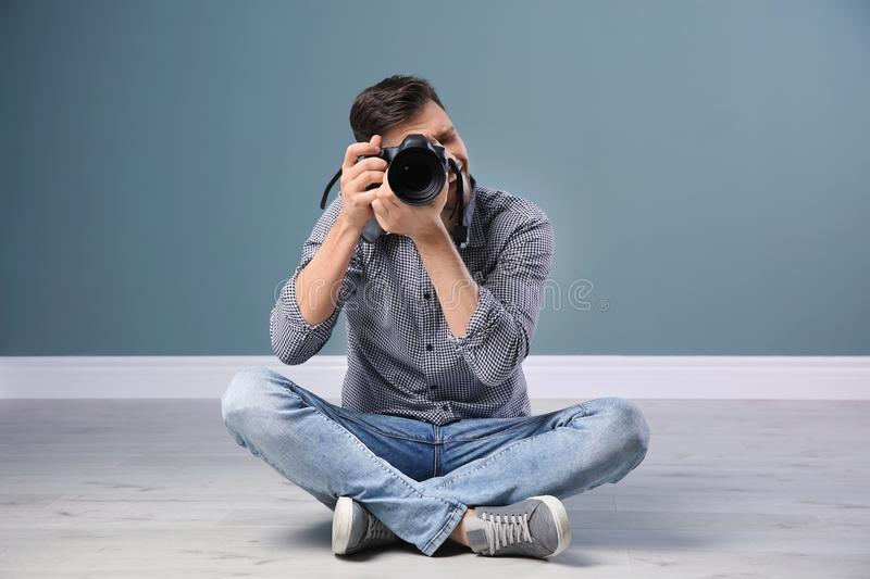 Male photographer with camera near wall royalty free stock images