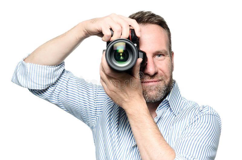 Male photographer focusing an image stock photography
