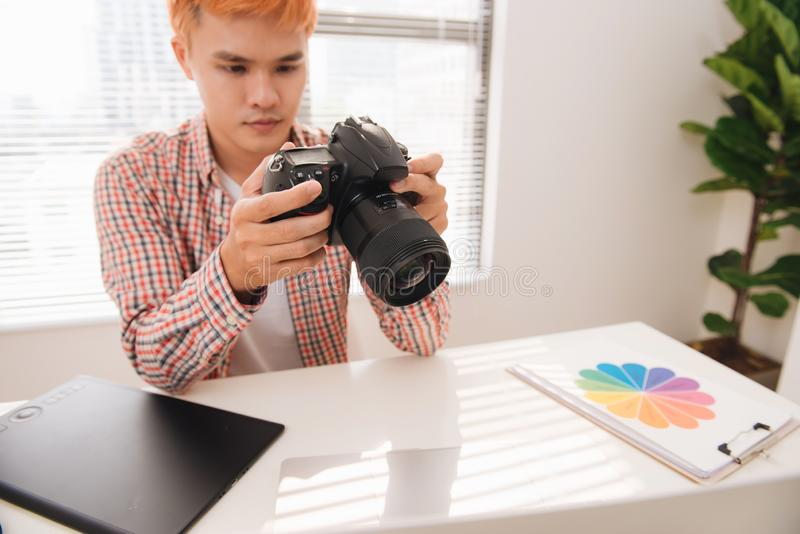 Male photographer, sitting at his desk, looking to camera royalty free stock images