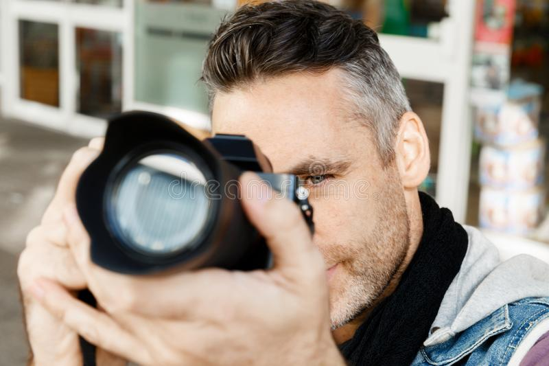 Male photographer taking picture stock photo