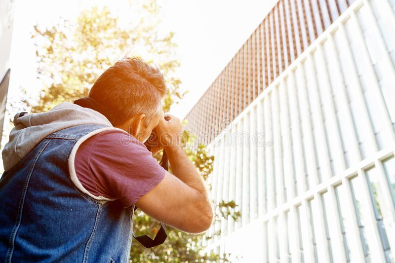 Male photographer taking picture stock photos