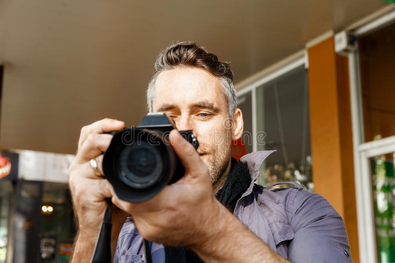Male photographer taking picture stock images