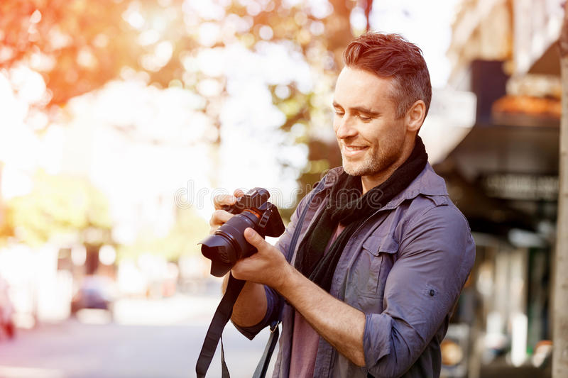 Male photographer taking picture royalty free stock image