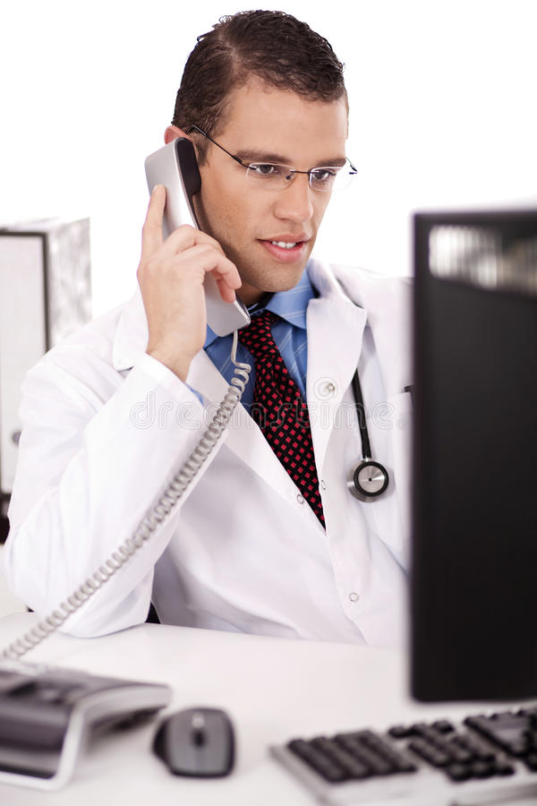 Male physician talking over phone royalty free stock photo