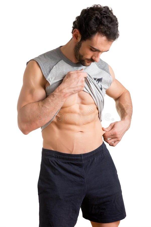 Male Pinching Fat From his Waist. Male athlete pinching fat from his waist, isolated in white stock photography