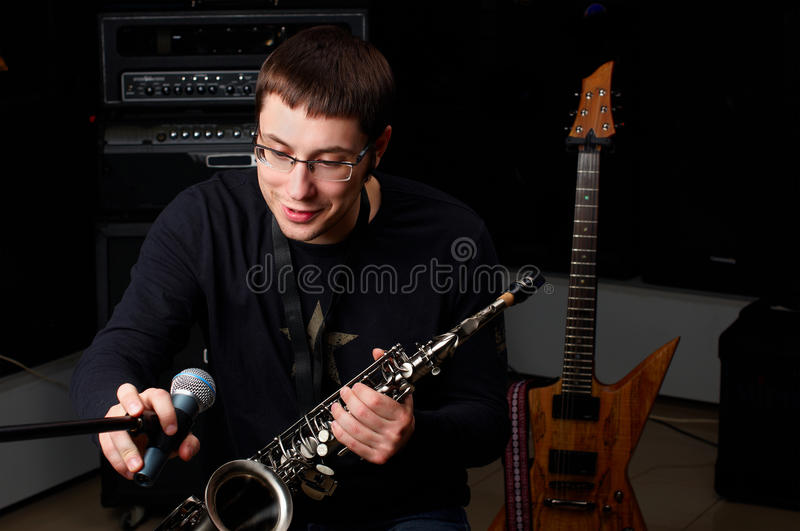 Download Male Play In Study On Saxophone Stock Photo - Image: 12340468