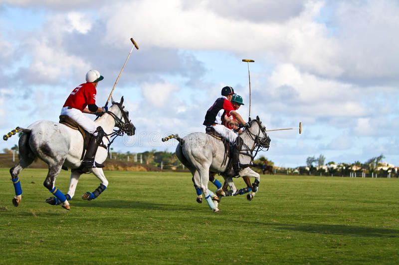 Male Polo Player. From the barbadian team at the Polo World championships in Barbados. Captain Leslie St. George Cheape from the England Polo Team racing with royalty free stock photography