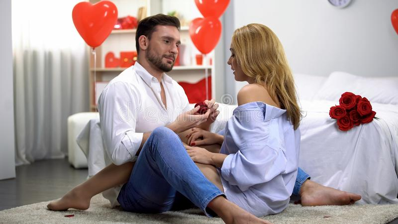 Male proposing lady on st Valentines day, romantic atmosphere, precious gift stock photo