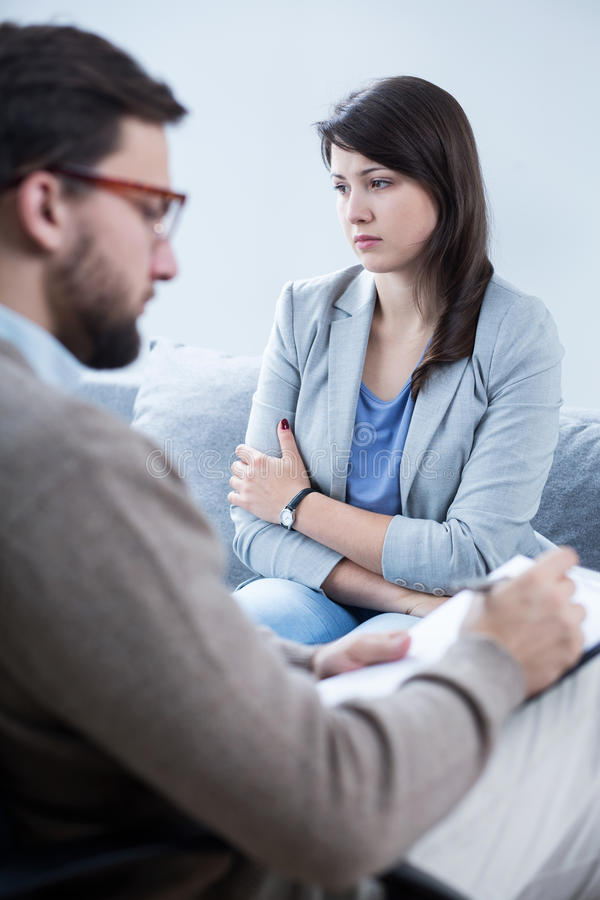 Male psychiatrist and his patient. Photo of male psychiatrist and his female patient royalty free stock photos