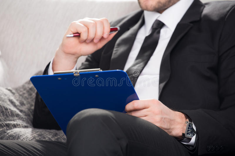 Male psychologist being ready to take notes stock photography