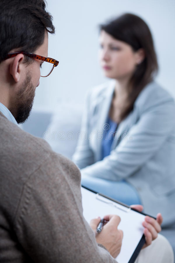 Free Male Psychotherapist Talking With Woman Stock Photography - 62119272
