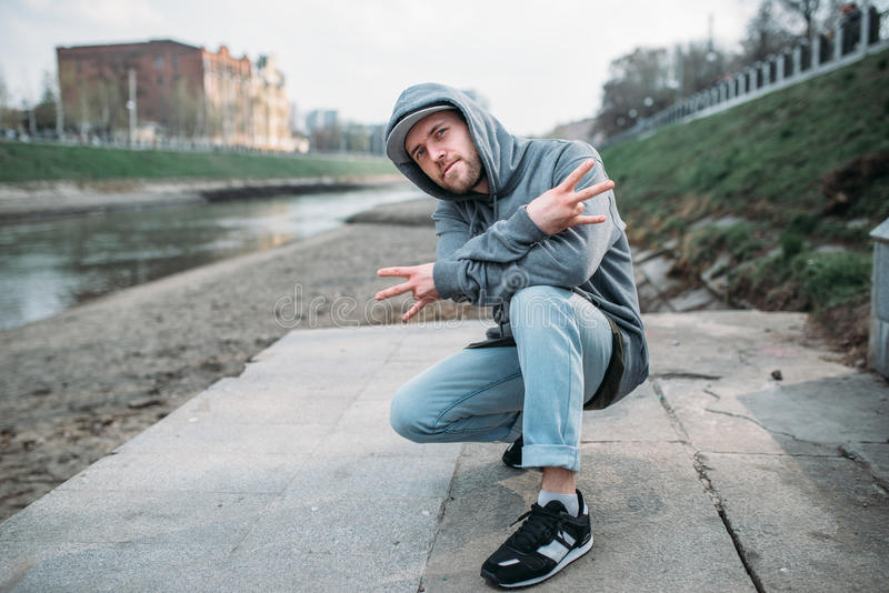 Male rapper posing on the street, urban dancing. Modern dance style stock photos