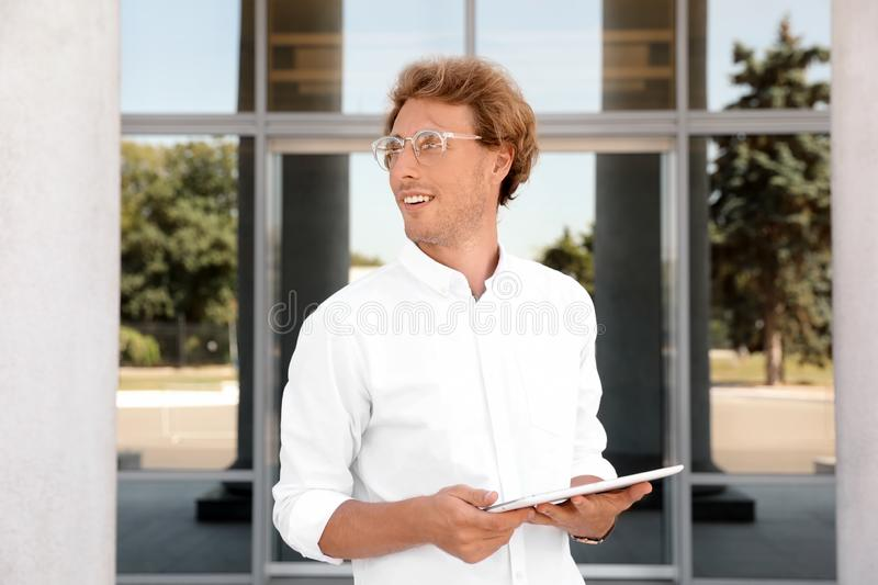 Male real estate agent with. Tablet outdoors stock photo