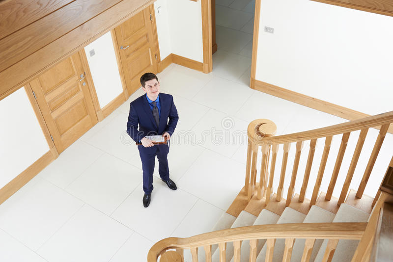 Male Realtor Looking Around Vacant New Property. Male Realtor Looks Around Vacant New Property royalty free stock photography
