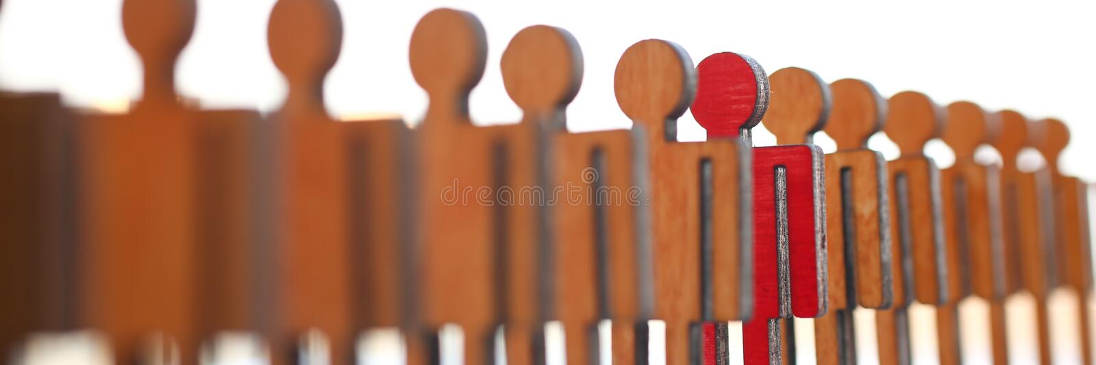 Male red plastic toy businessman silhouette. Wooden figure background closeup. Manipulate work recruitment transfer labour inspectorate experience exchange man royalty free stock photography