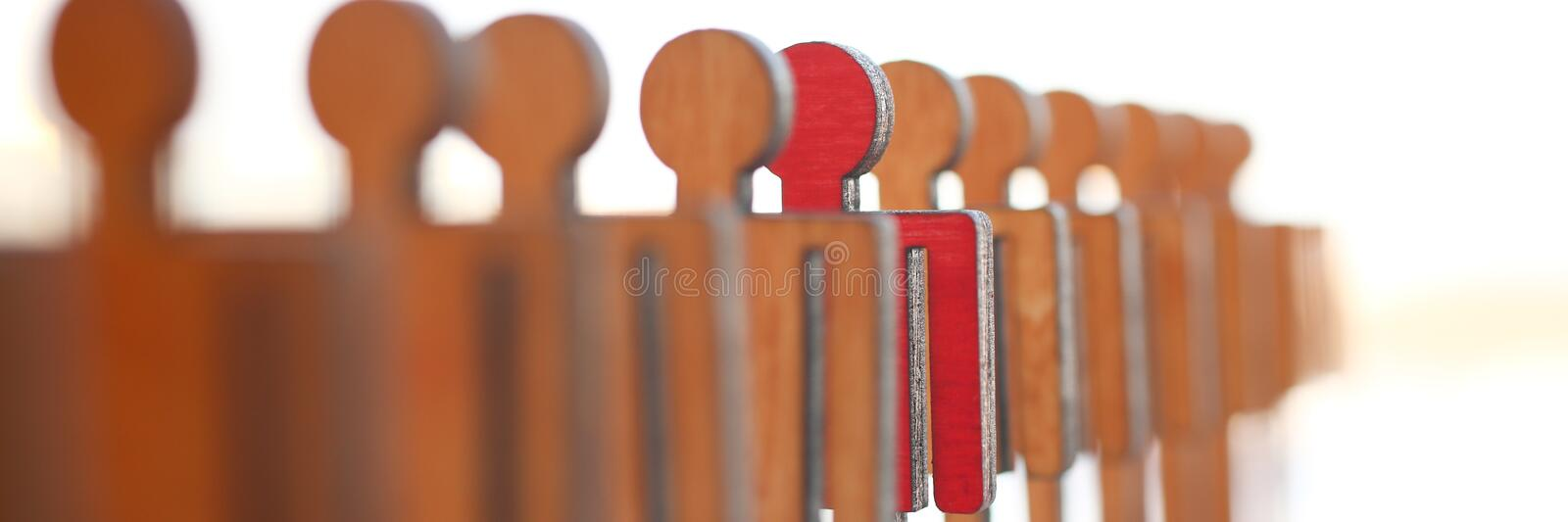 Male red plastic toy businessman silhouette. Wooden figure background closeup. Manipulate work recruitment transfer labour inspectorate experience exchange man stock photo
