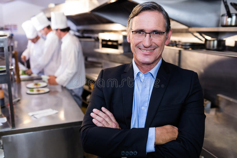 Male restaurant manager standing with arms crossed stock images