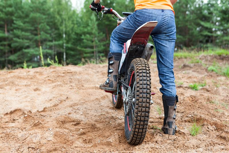 Male rider on motorcycle rides the sand. Extreme sports on motorcross motorcycles royalty free stock photo