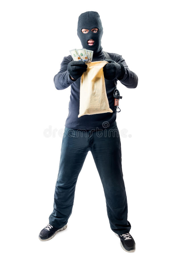 Male robber in full length is holding bag with money. On white background royalty free stock photo