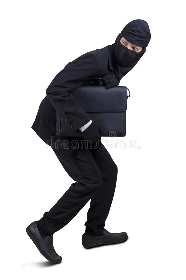 Male robber stealing a briefcase stock photography